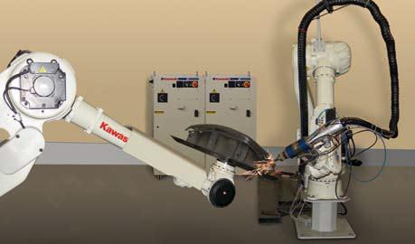 Proces cięcia laserem realizowany przez dwa roboty Kawasaki