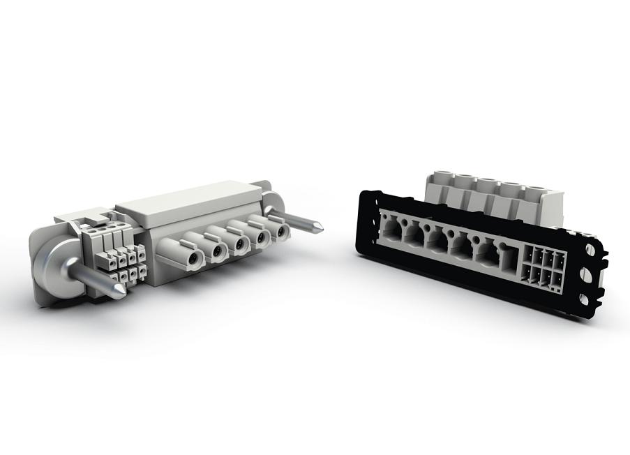 Fot. 2 Przykład hybrydowego przyłącza modułowego opartego o system Variocon firmy Phoenix Contact. Widoczne są metalowe piny pozycjonujące oraz czarna rama montażowa zapewniająca kompensację tolerancji.