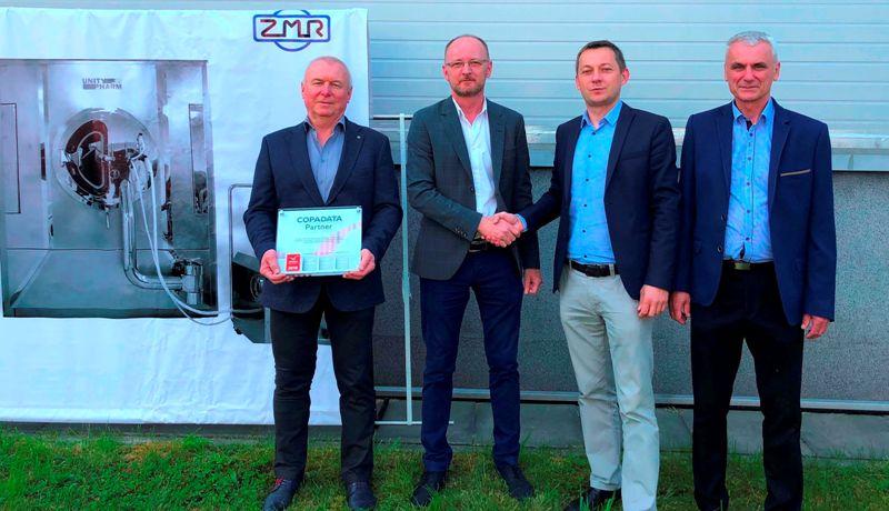 Na zdjęciu współwłaściciele firmy ZMR (od lewej: Wojciech Ciaćma, Dariusz Reikowski, Marian Piec oraz Tomasz Papaj dyrektor sprzedaży COPA-DATA Polska Sp. z o.o. ( trzeci od lewej).