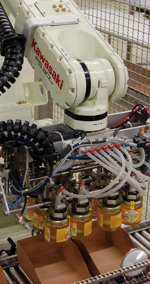 Robot FS30L pakuje słoiki z miodem